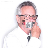 Congressman Lowenthal with a piece of tape over his mouth