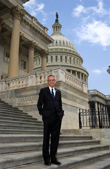 Congressman Lowenthal standing on the steps of the US Capitol building